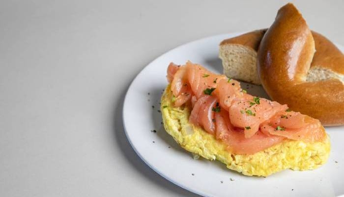 bagel with omelet and lox on the side